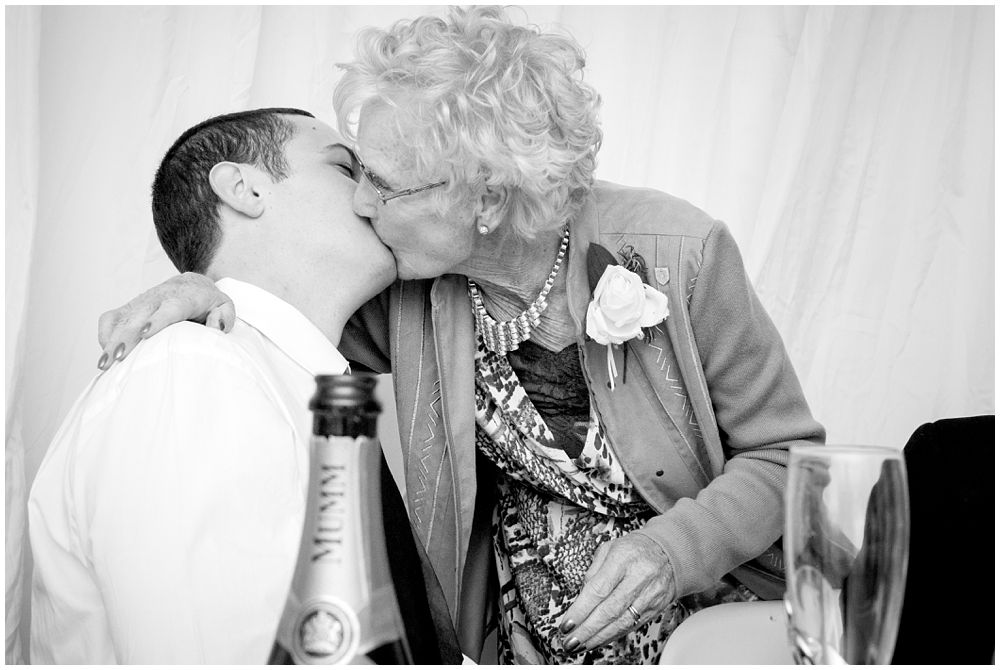 Grandma Kiss planted on the groom during a wedding reception
