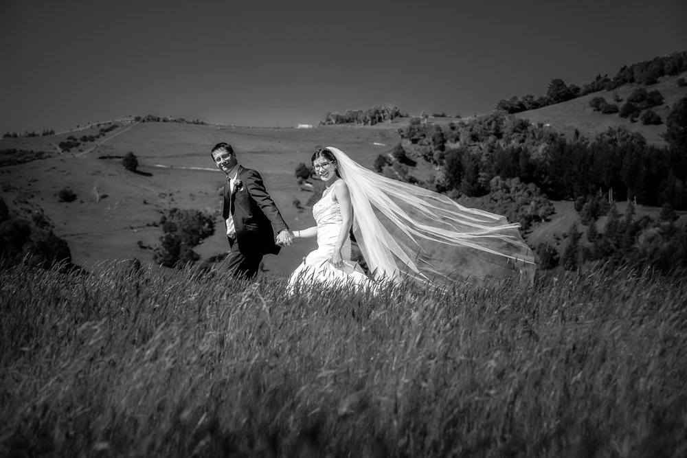 Akaroa Wedding Photographer With The Bride And Groom In A Paddock At Mt Vernon Lodge
