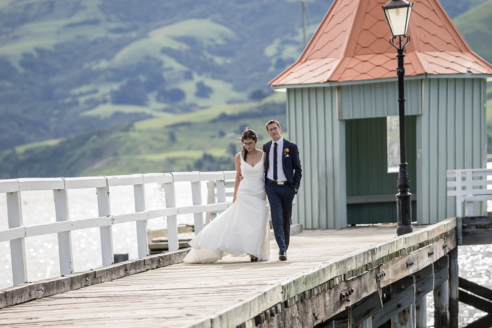 Akaroa Wedding Photographer With The Bride And Groom At Harbour