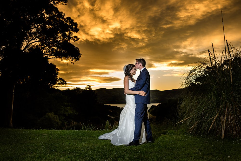 Akaroa Wedding Photographer With The Bride And Groom At Sunset Mt Vernon Lodge
