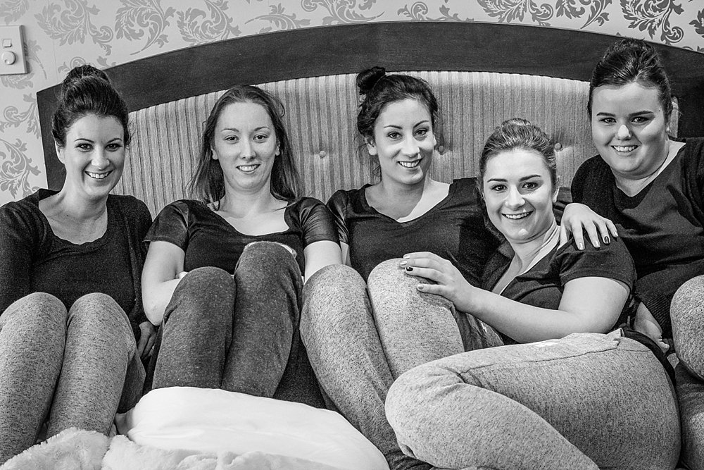 Melton Estate Wedding-Bridesmaids relaxing on bed