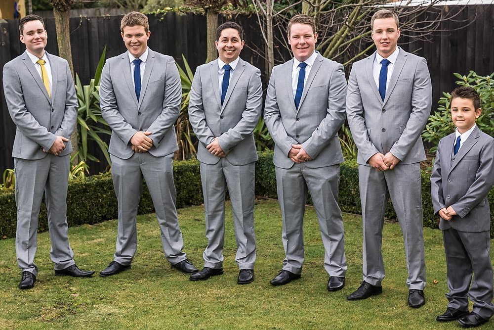 line up photo of the groomsmen and the page boy at a Christchurch Wedding