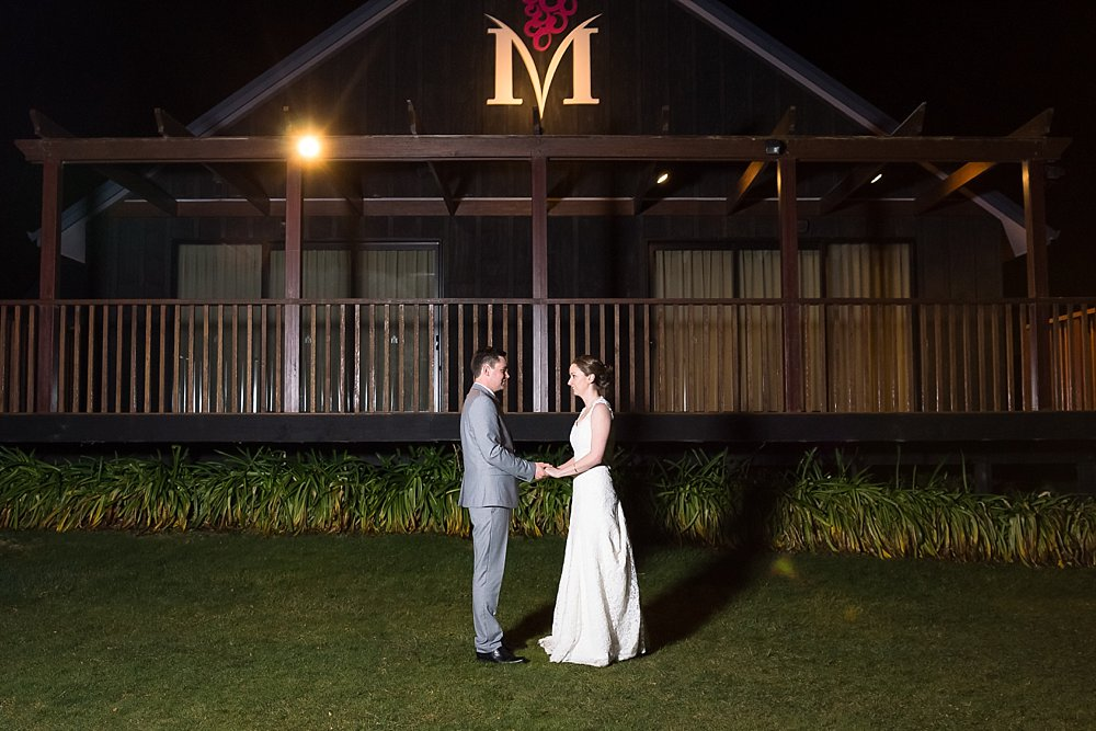 Night photo bride and groom in front of the Melton Estate Wedding Venue