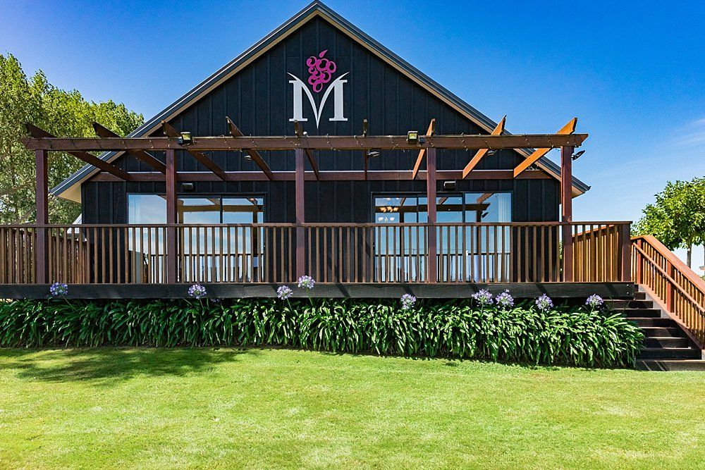 Main deck with a venue brand on the side of the wall at Melton Estate Wedding Venue, Christchurch