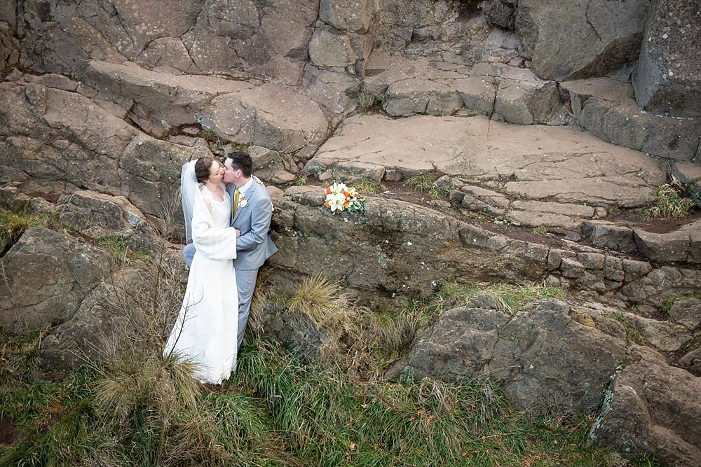 Melton Estate Wedding-bride and groom with rock boulders background
