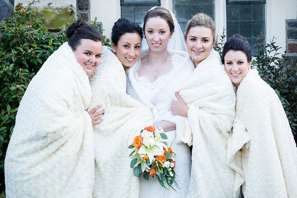 Melton Estate Wedding-bridesmaids huddled to keep warm during winter wedding