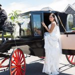 Stoneleigh Lodge photo bride getting into a horse draw carriage