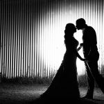A black and white silhouette Wedding photograph of the bride and groom