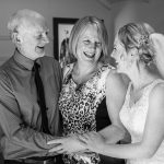 wedding photo of the bride and her happy parents