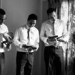 photograph of the groomsmen opening their presents from the groom
