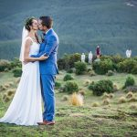 wedding photo of bride and groom kissing at the top of a ridge during a wedding in Lorburn near Rangiora