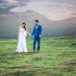 wedding photo of bride and groom taking a walk at the top of a ridge during a wedding in Lorburn near Rangiora