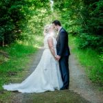 Hanmer Heritage Hotel wedding with a forest photo of the bride and groom backlit with a flash