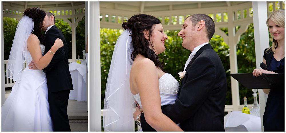 couple kissing on wedding day by christchurch wedding photographers Pip and Oz