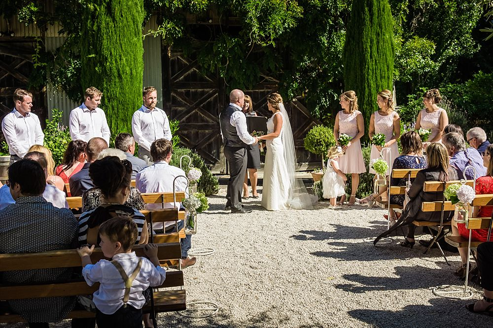 Wedding ceremony in courtyard at Cossars Wineshed wedding venue