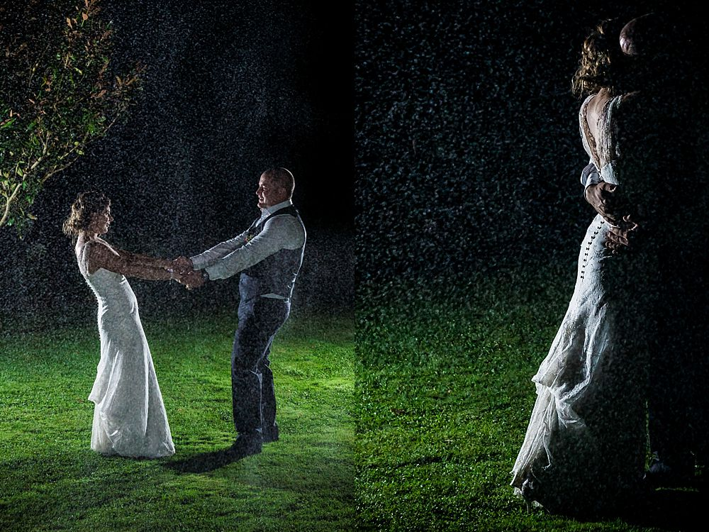Bride and groom dance in the rain at Cossars Wineshed Wedding Venue in Christchurch