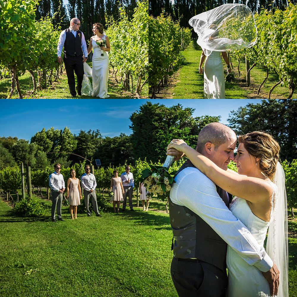 Wedding party posing for photos in the vineyard at Cossars Wineshed Wedding Venue in Christchurch