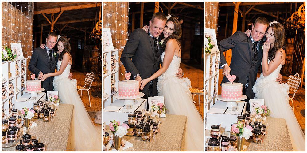 Couple cutting the wedding cake on wedding day