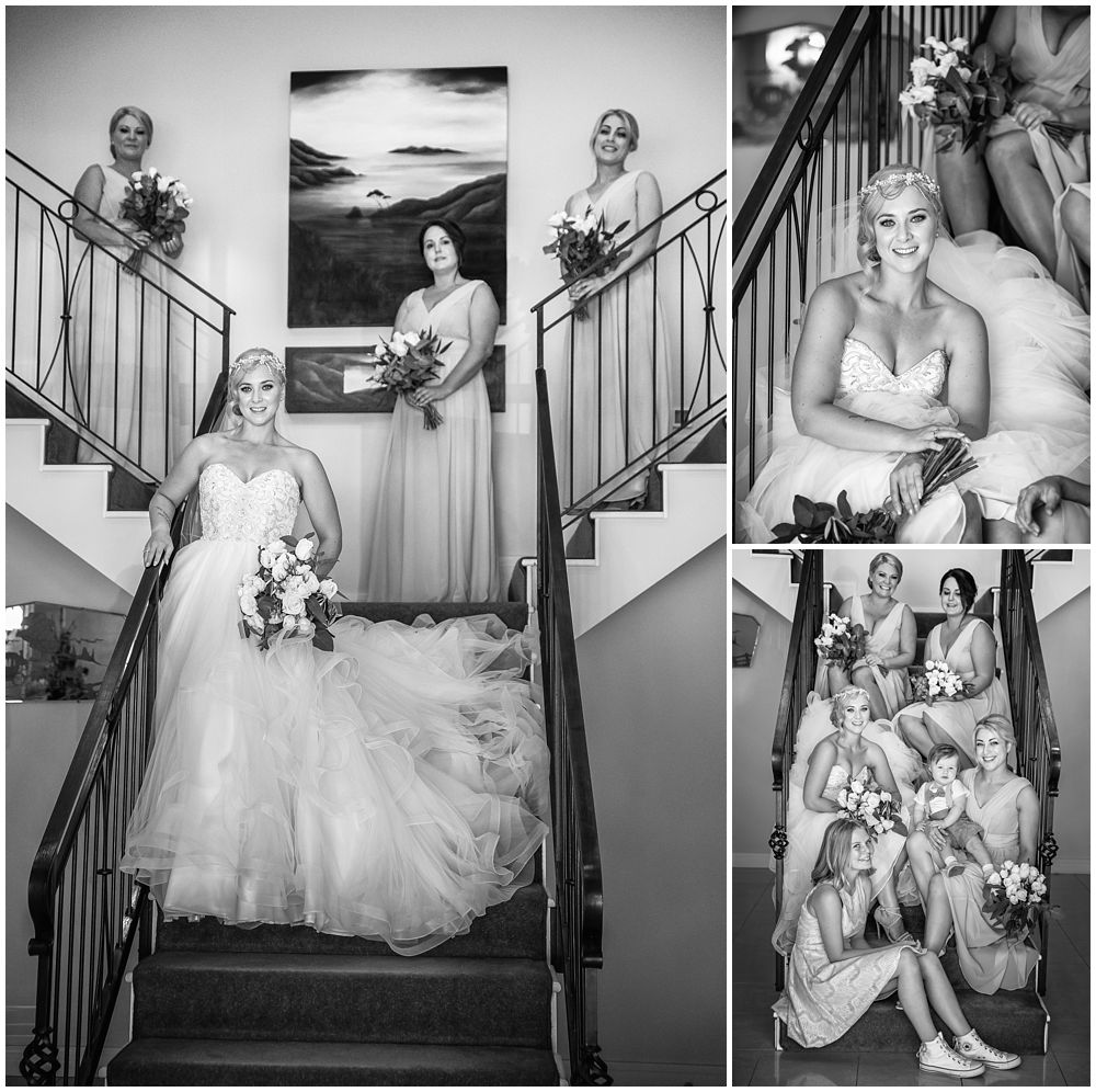 bride with girl on stairs at Flaxton Manor