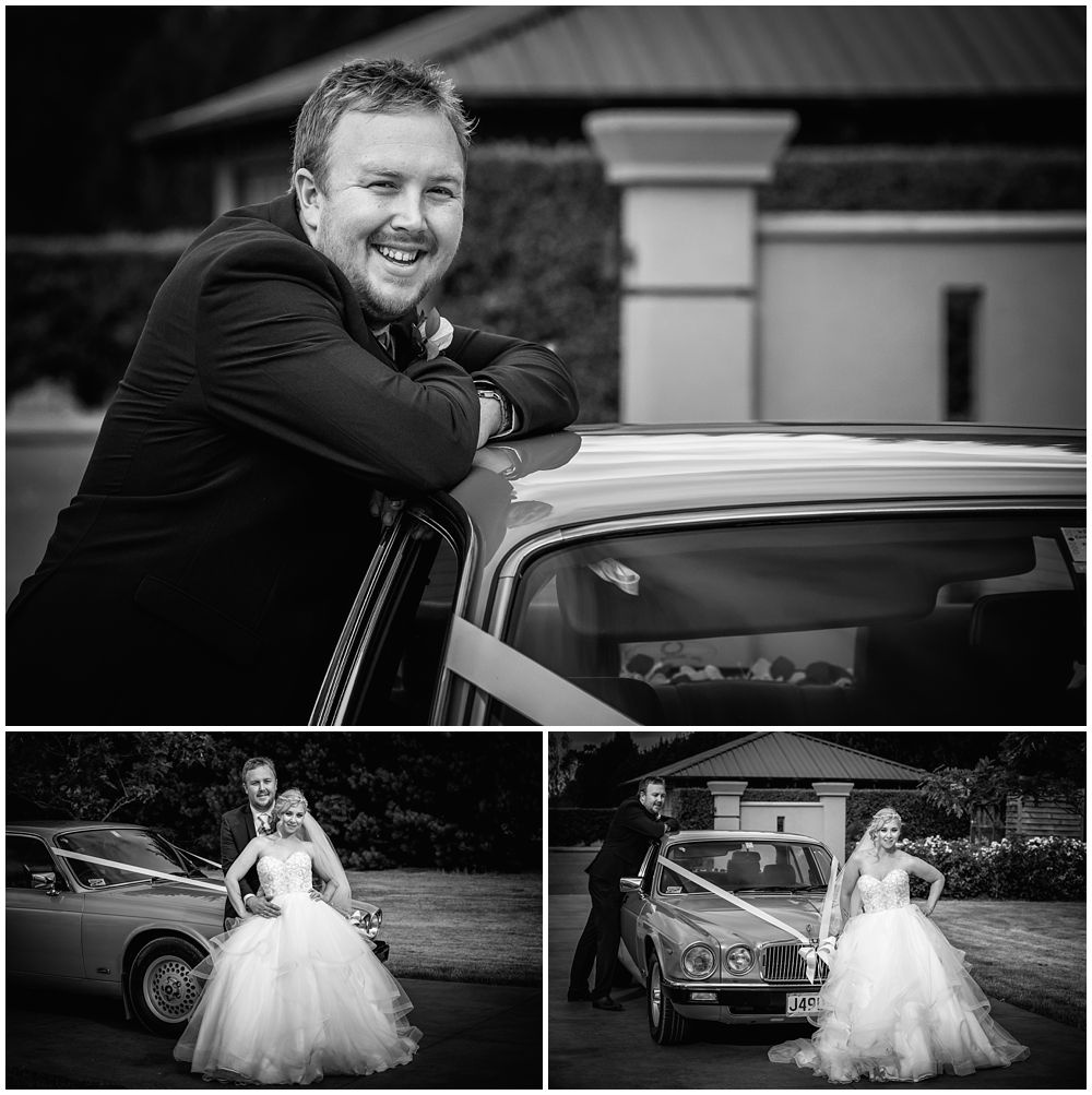 Bride and groom standing by bridal car