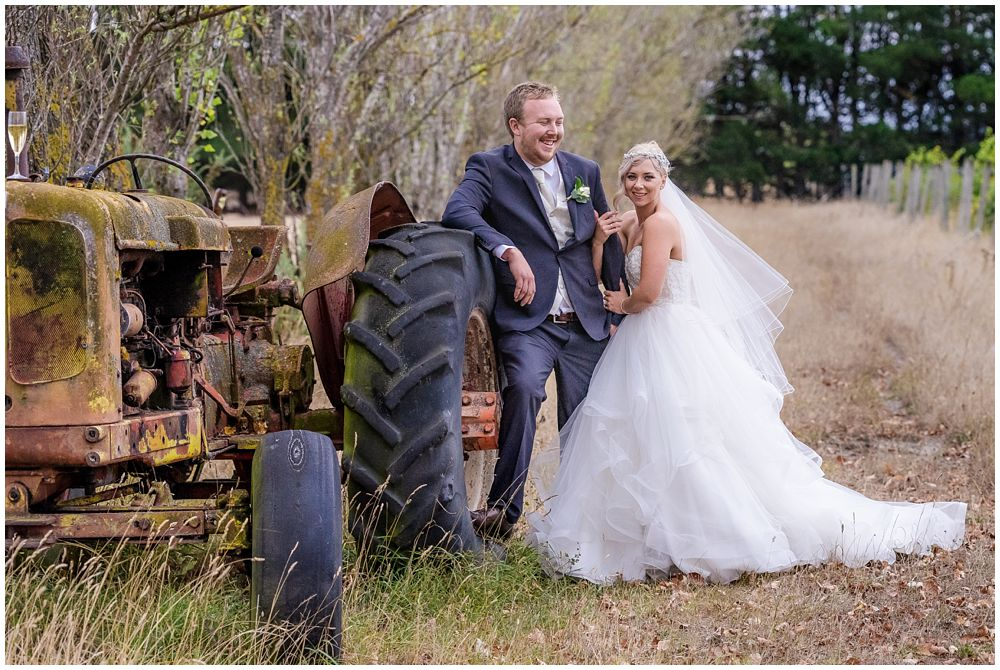 Darjon Vineyard Wedding Venue couple by vintage tractor