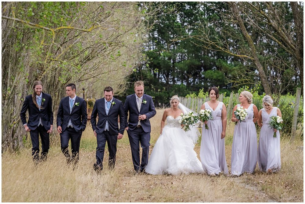 Bridal party walk in line at Darjon Vineyard Wedding Venue