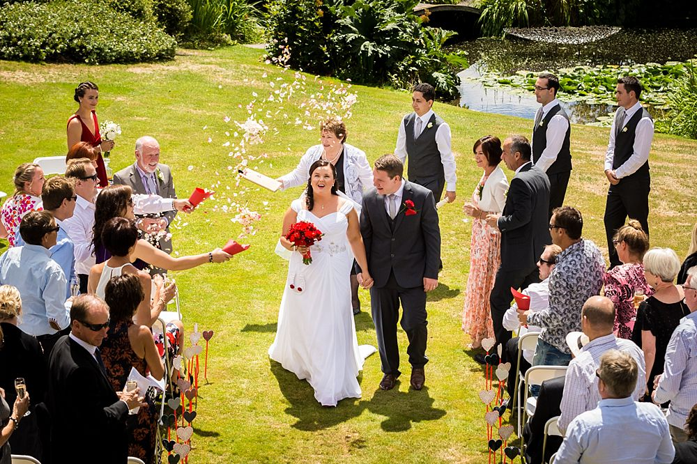 Bride and groom walk out at the end of the ceremony at Flaxmere Garden Wedding Venue