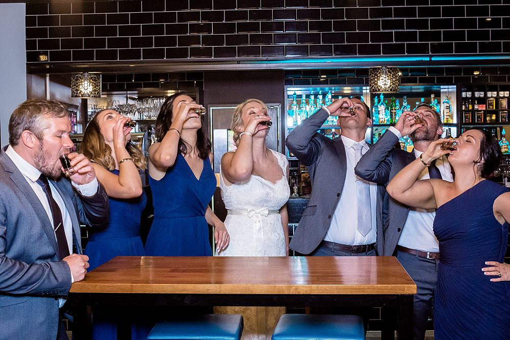 The Gym Art Centre Wedding-Bridal party take a shot of sambuca at local bar