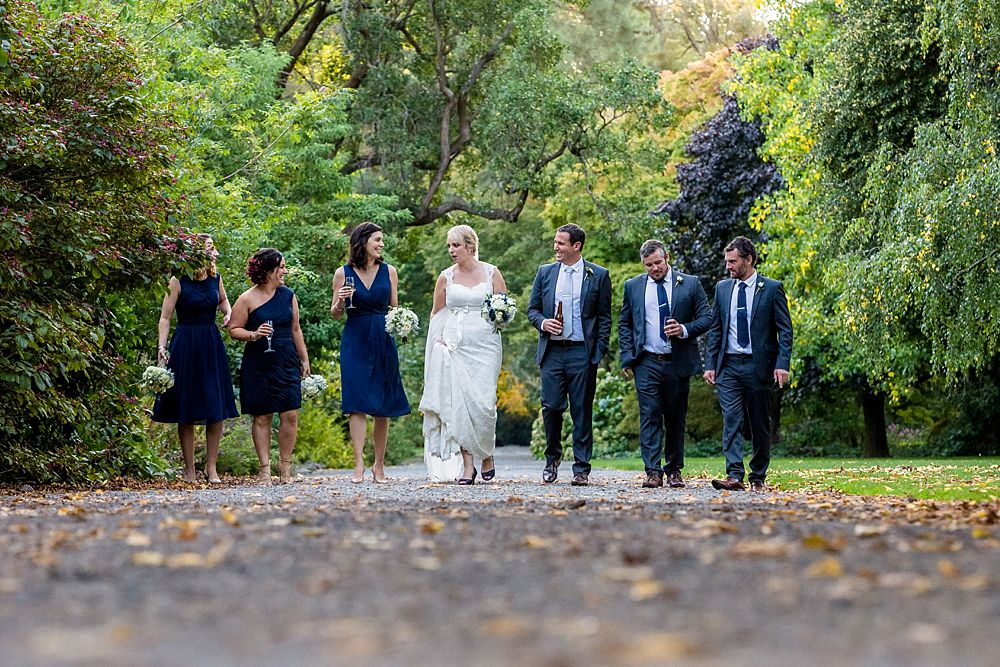 The Gym Art Centre Wedding-Bridal party walking in line on a path in Botanical Gardens-Christchurch