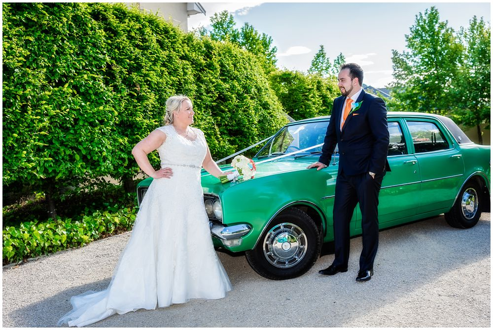 Heritage Hanmer Springs Wedding-bride and groom standing by the bridal car