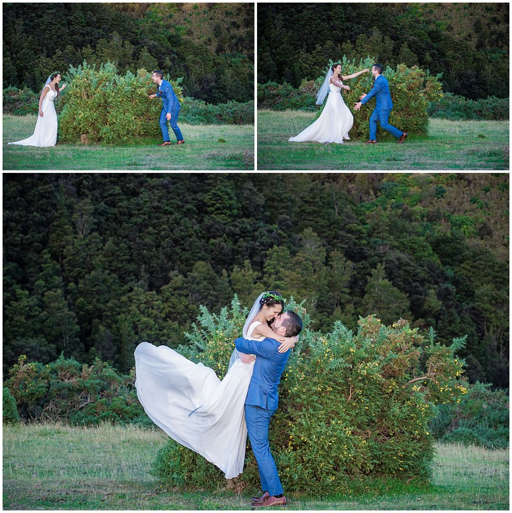 Bride and groom surprise each other from behind the bushes and end up with a big hug