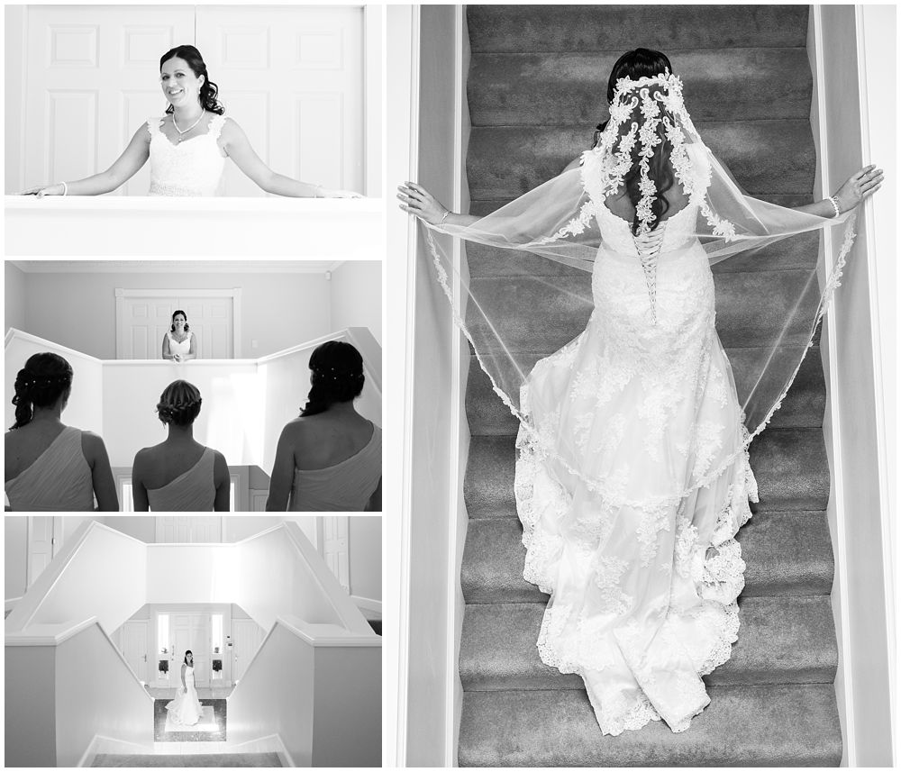Rosemount Estate Wedding-bride in wedding dress by stairs and front door in Ohoka