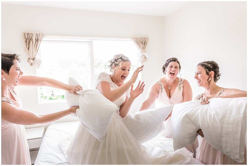 Tannery Wedding-Bridesmaids and bride having a pillow fight