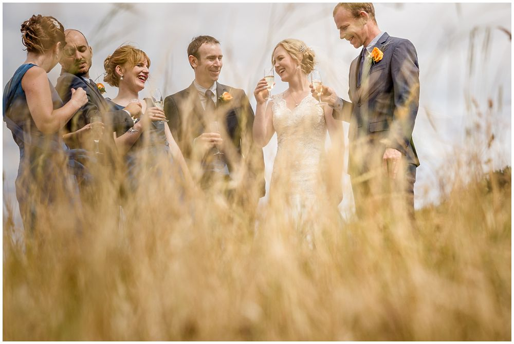 Tipapa Woolshep Wedding Bridal party drinking wine shot through long dry grass