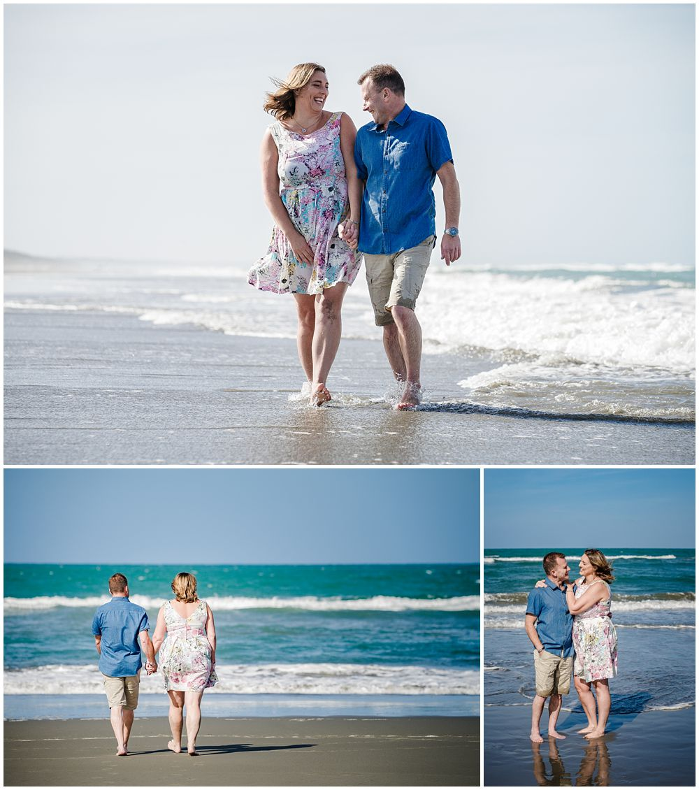 Couple walking on the beach at engagement shoot