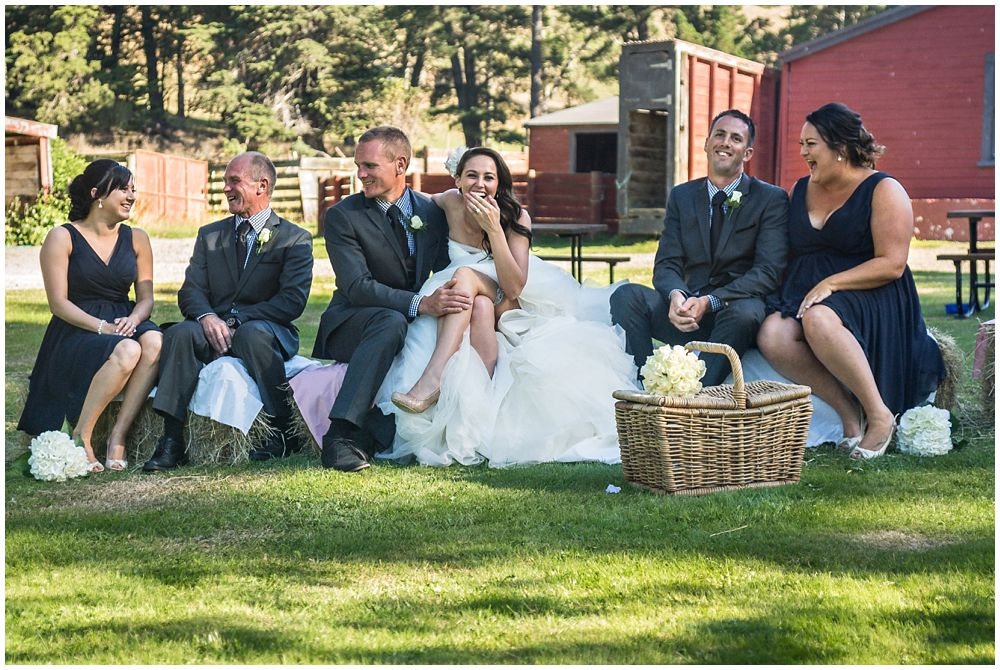 Tipapa Woolshed Barn Wedding Venue bridal party sitting on hay bails