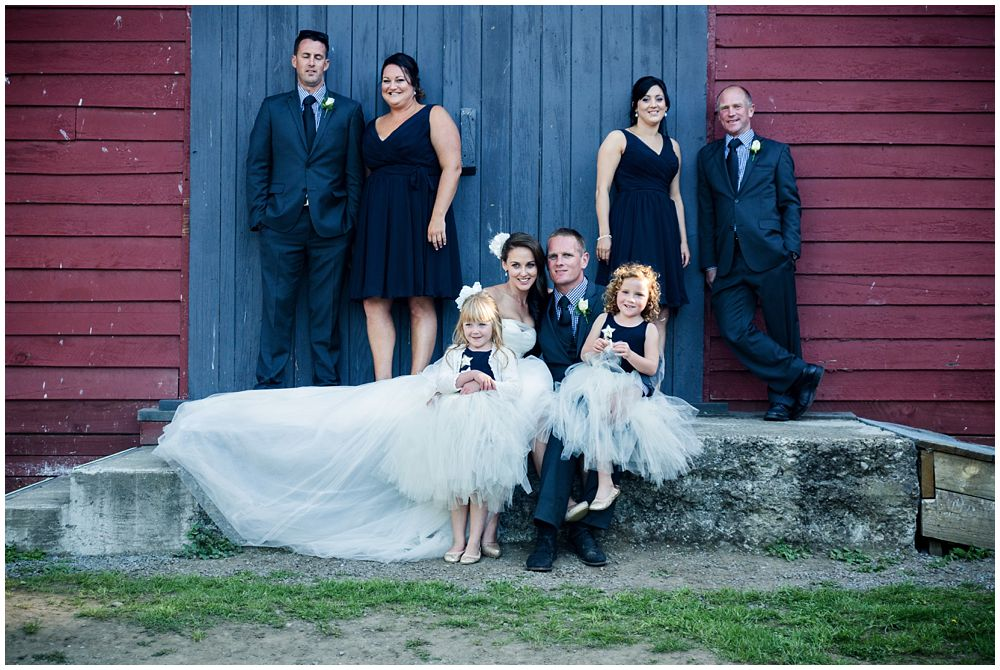 Bridal party infant of barn door Tipapa Woolshed Barn Wedding Venue
