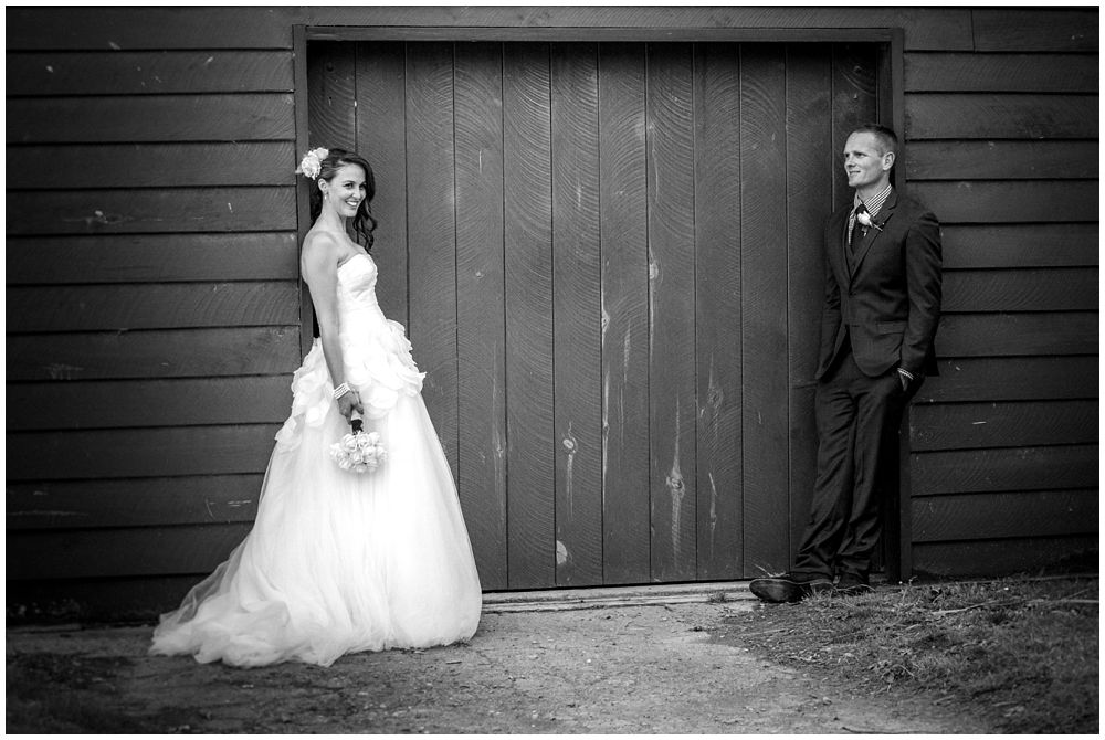 bride-groom standing facing ivy barn at Tipapa Woolshed Barn Wedding Venue