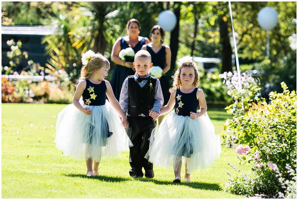 Flower girls-pageboy walking the aisle at Tipapa Woolshed Barn Wedding Venue