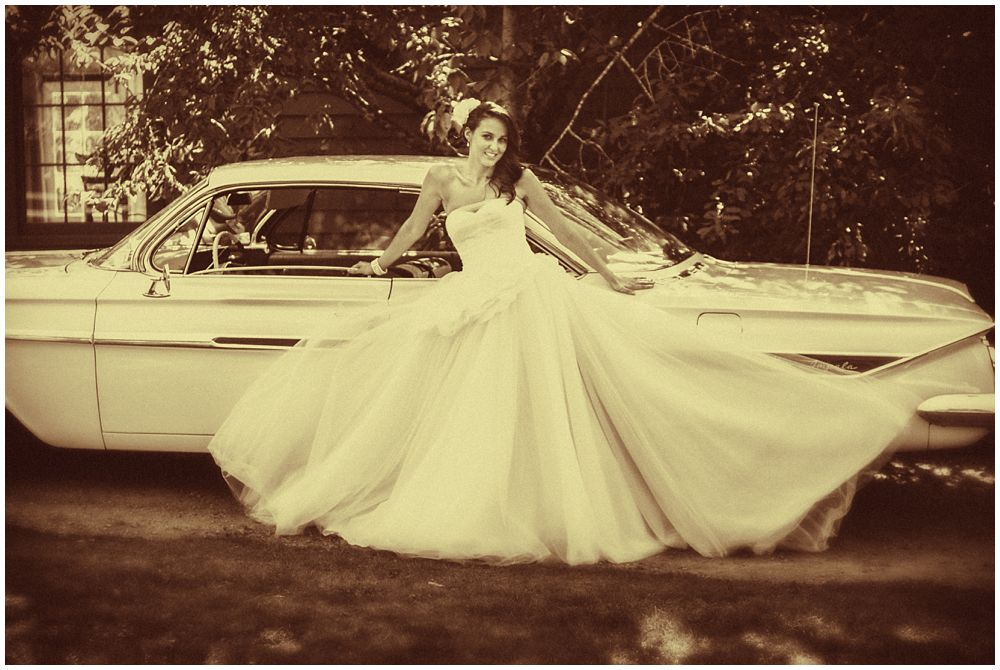 Tipapa Woolshed Barn Wedding bride leaning on vintage car