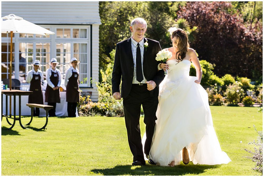 Tipapa Woolshed Wedding Venue bride walks down aisle with father