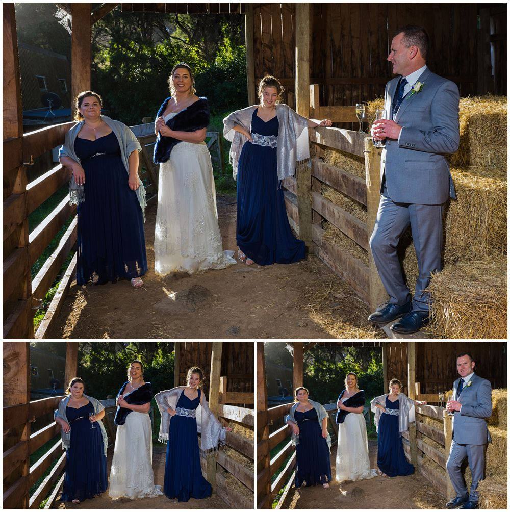 groom and girls in a barn