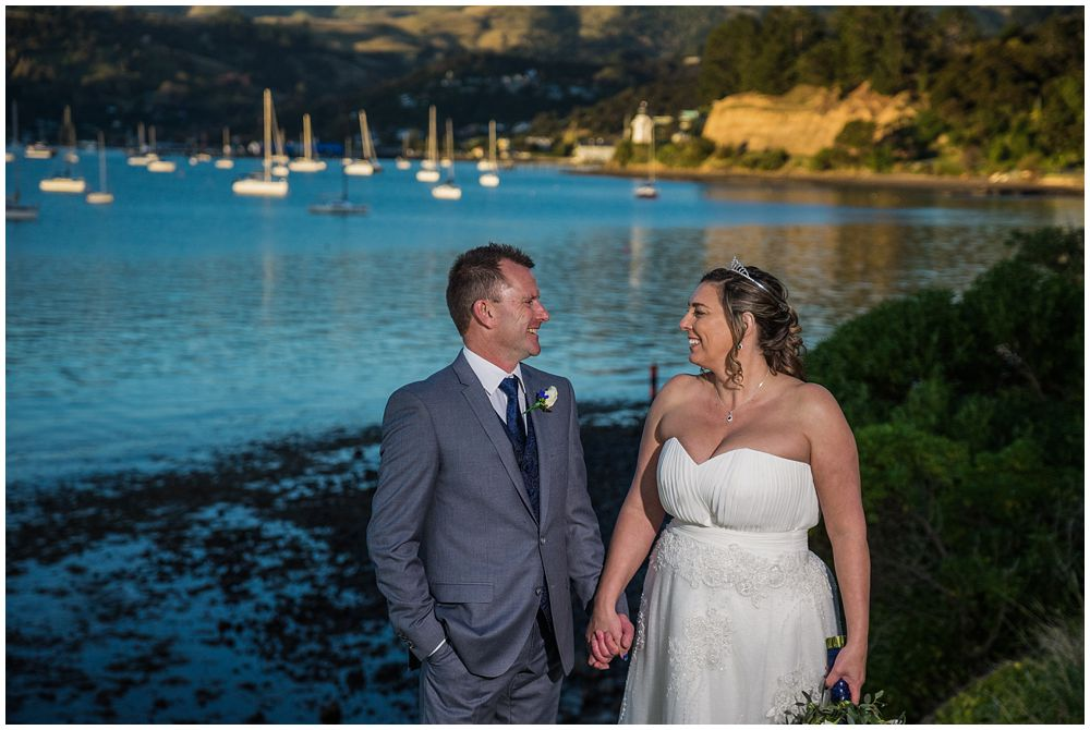 wedding couple standing in front of harbour
