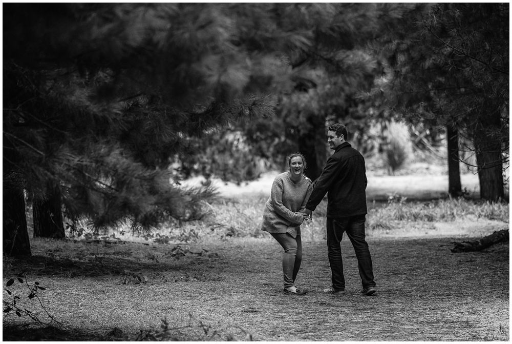 Couple having a laugh in Bottle Lake Forest