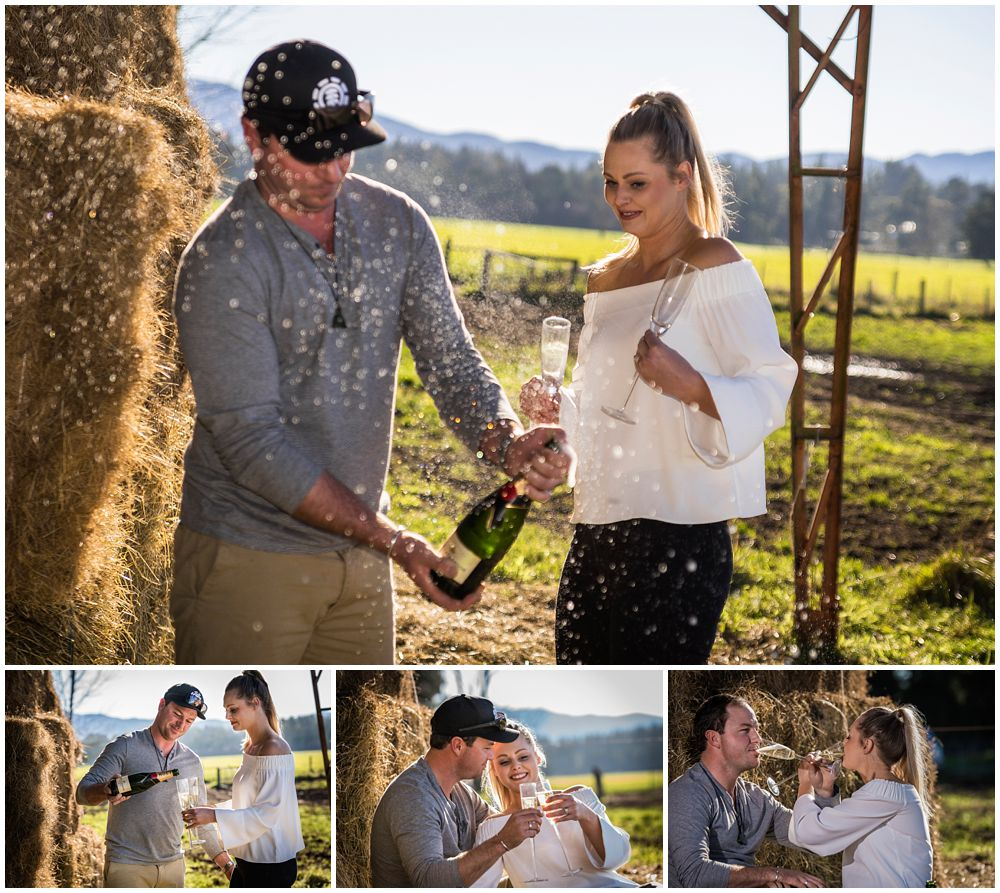 Couple posing and drinking a bottle of bubbles