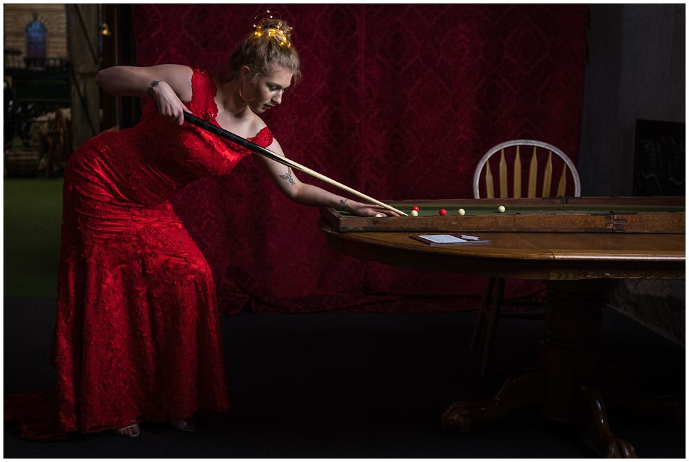 bride in red dress playing pool christchurch wedding photographer photo