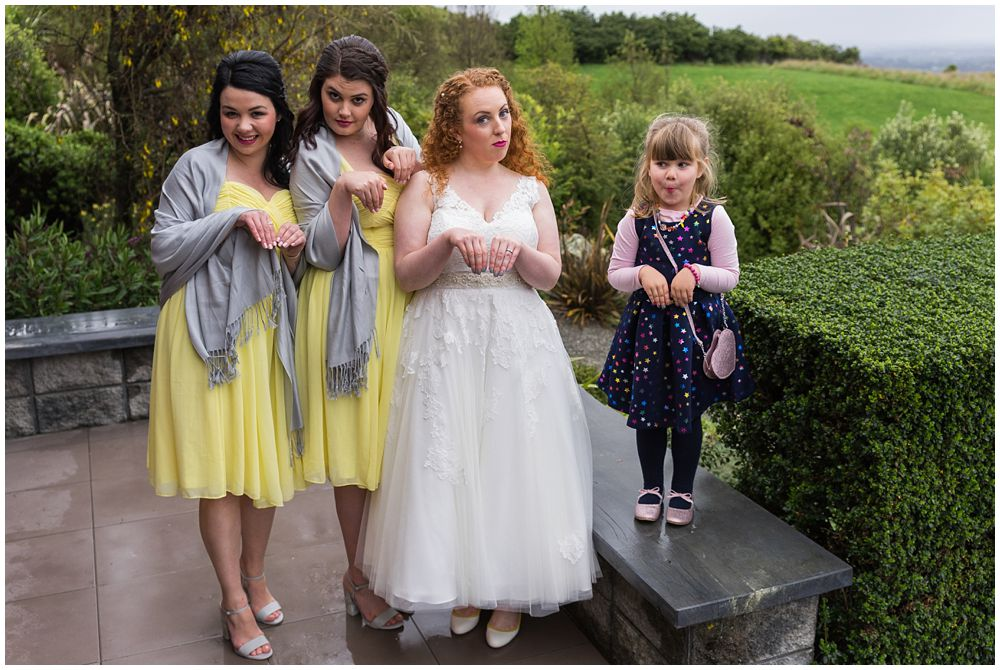 Bride and bridesmaids pose for photos waipuna estate wedding