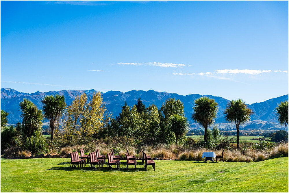 Braemar Lodge Wedding venue Hanmer Springs lawn ceremony setup with chairs and signing table