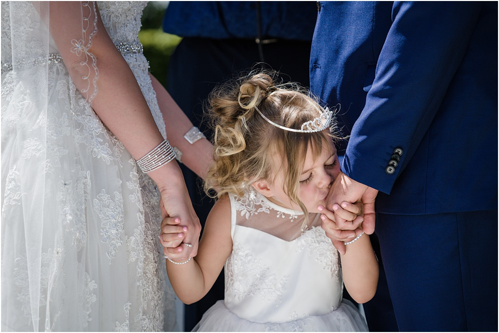 flower girl kisses dads hand during the ceremony at lacebark venue