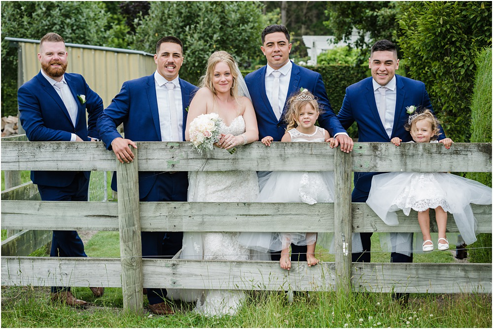 bridal party infront of a wooden fence at a lacebark wedding